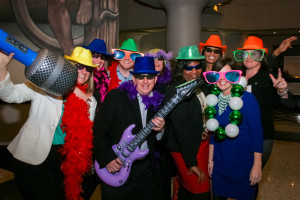 This is an example photograph showing a group of people at a corporate party wearing goofy clothing with props. Whether the event is a corporate luncheon, award ceremony or morale building, we capture those memorable moments that everyone will talk about.