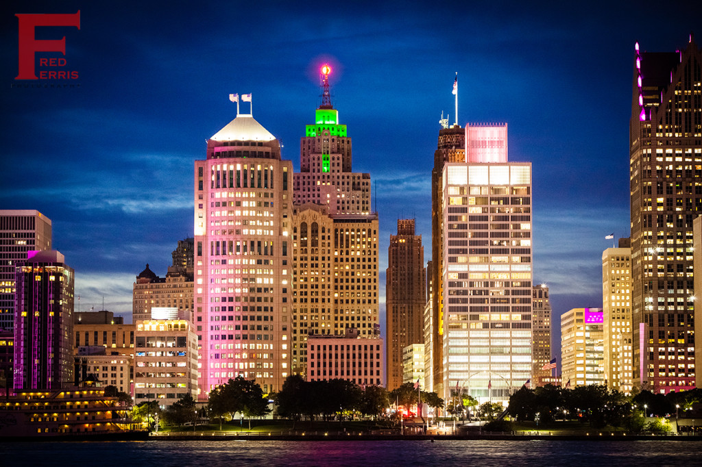 Fred Ferris Photography | Nighttime Detroit skyline with green flooded top of the Penopscot Building as the center of focus