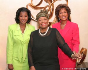 This is an event photograph that shows Maya Angelou posing with Dana and Glenda Lewis, WXYZ-TV, at a charity event.